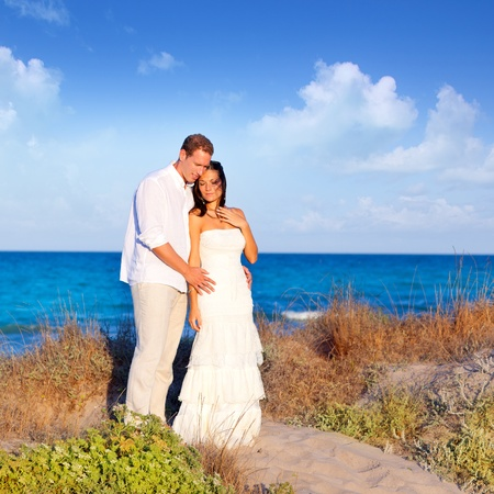 couple in love in the beach dune on Mediterranean sea photo