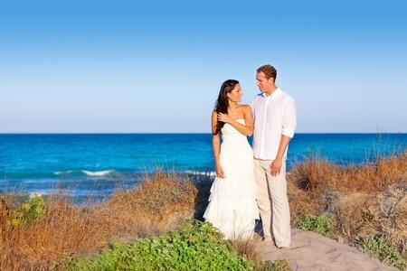 couple in love in the beach dune on Mediterranean sea photo