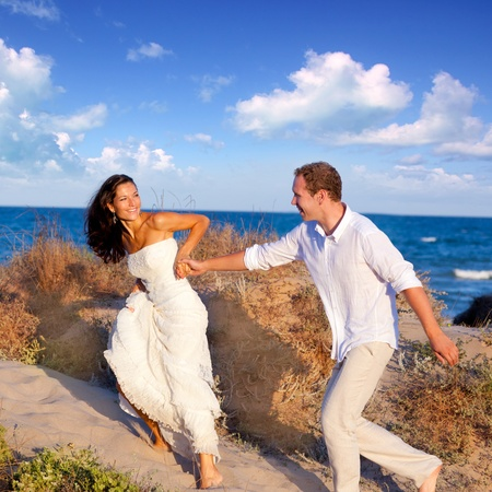 couple in love running at the beach on Mediterranean photo