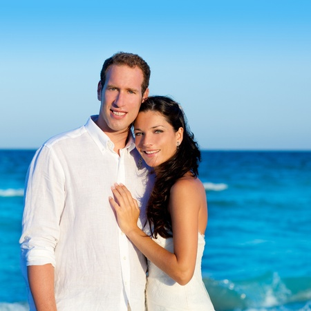 couple in love hug in blue sea vacation in Spain photo
