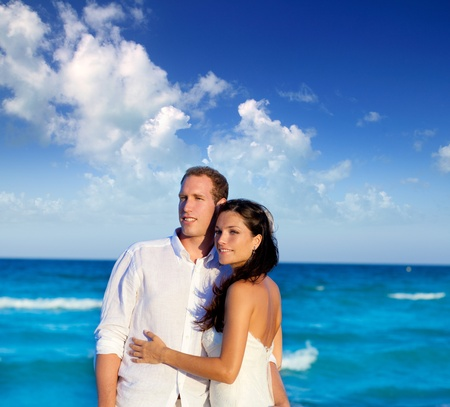 love expression: couple in love hug in blue sea vacation in Spain