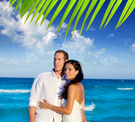couple in love hug in blue sea vacation in Spain