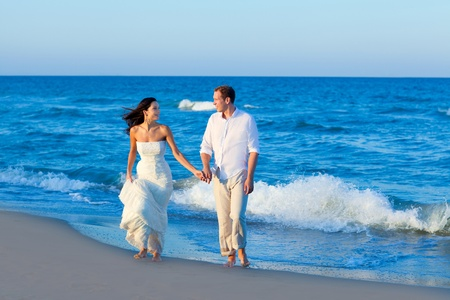 wedding beach: Mediterranean couple walking in blue beach shore