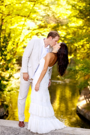 lovers kissing: couple kissing in honeymoon outdoor autumn park Stock Photo
