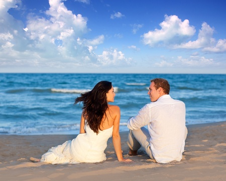 married couples: couple in love sitting in blue beach on vacation travel