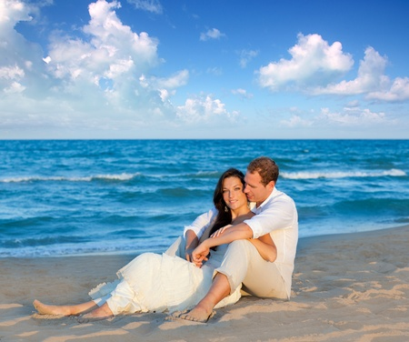 woman beach dress: couple in love sitting in blue beach on vacation travel