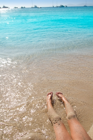 girl legs: Children girl legs in beach sand shore at summer vacation Stock Photo