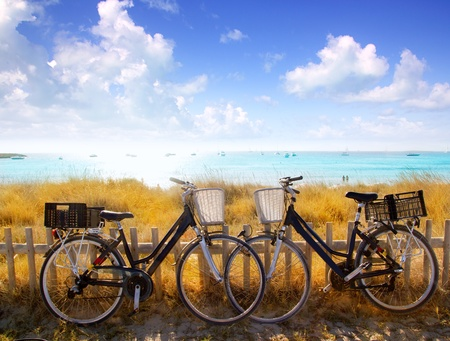 parked bicycles: bicycles couple parked in Formentera beach of Illetes
