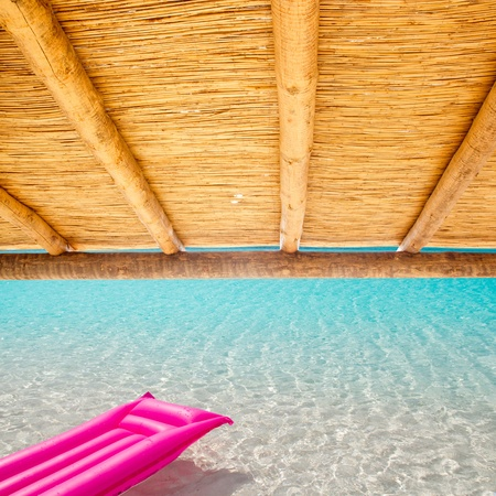 sunroof: Cane sunroof with tropical perfect beach and  pink float Stock Photo