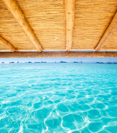sunroof: Cane sunroof with tropical perfect beach of Illetes Formentera island Stock Photo