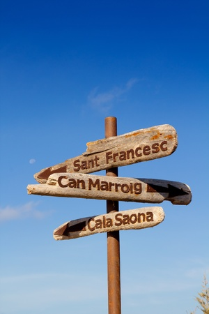 direction board: Formentera wood road signs Can Marroig Cala Saona Sant Francesc Stock Photo