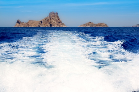 Ibiza Es Vedra from boat prop wash wake in Balearic Mediterranean sea photo