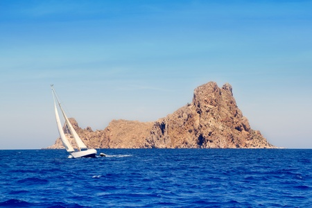 Ibiza sailboat in Es Vedra island at Mediterranean blue sea photo