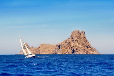 vedra: Ibiza sailboat in Es Vedra island at Mediterranean blue sea