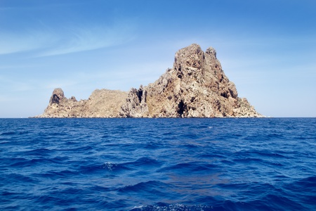 vedra: Ibiza Es Vedra island in Mediterranean blue Balearic sea Stock Photo