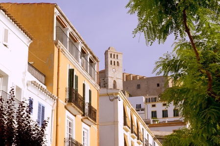 spanish landscapes: Ibiza town Eivissa houses and hig up church in balearic islands