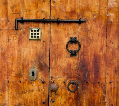 Aged old golden wood door from Ibiza downtown photo