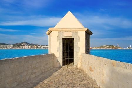 Ibiza watchtower with Eivissa port view in Balearic islands photo