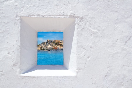 Ibiza mediterranean white wall window with Eivissa town view Stock Photo
