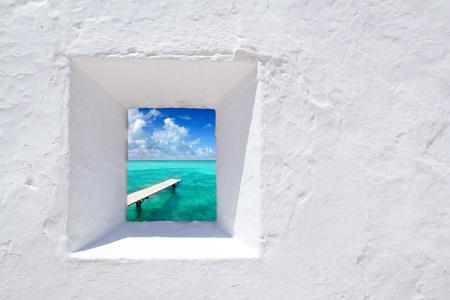 Ibiza mediterranean white wall window with Formentera beach view