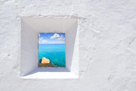Ibiza mediterranean white wall window with Formentera beach view photo