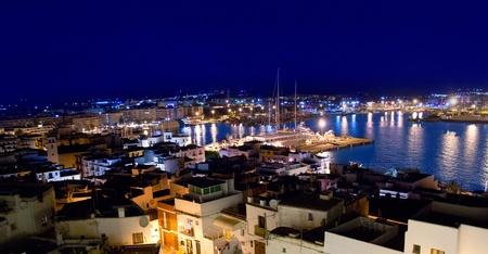 Ibiza downtown eivissa high angle night view with blue mediterranean sea