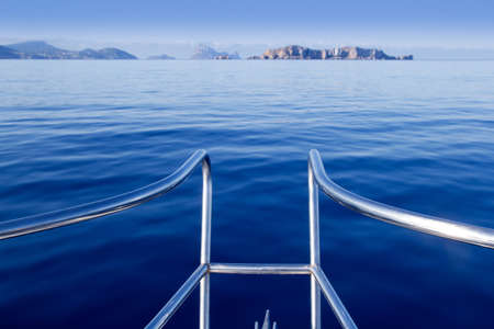 Boat bow in ibiza sailing to Esparto island with Es Vedra background photo
