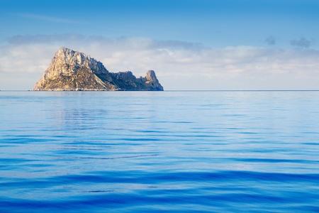 Ibiza Es Vedra island in calm blue Mediterranean water photo
