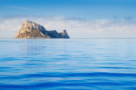 vedra: Ibiza Es Vedra island in calm blue Mediterranean water Stock Photo