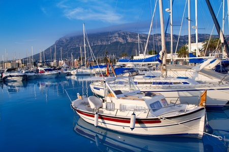 Denia marina port boats and Mongo mountain in Alicante Spain photo