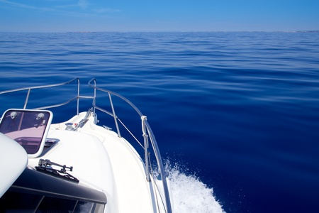 bow of boat: Boat bow open porthole sailing in blue calm sea during summer vacations Stock Photo
