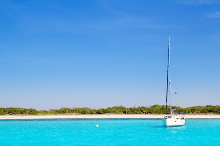 Luxury sailboat in turquoise beach of Formentera Illetes photo