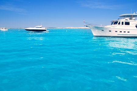 motorboat: Luxury yatch in turquoise beach of Formentera Illetes Stock Photo