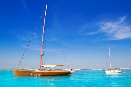 Luxury sailboat in turquoise beach of Formentera Illetes photo
