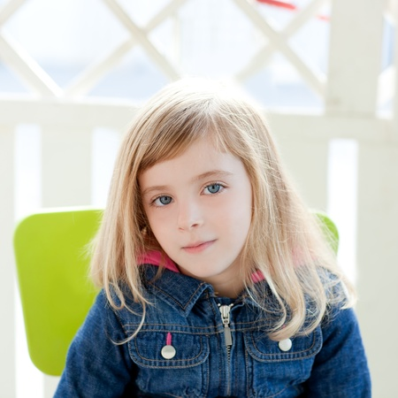 little girl posing: blue eyes kid girl portrait outdoor sit in green chair