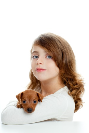 Brunette kid girl with puppy dog mascot mini pinscher on white background photo