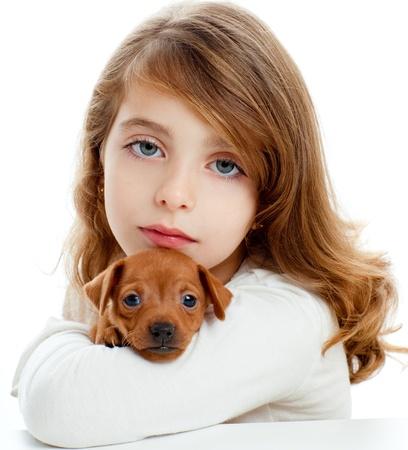 Brunette kid girl with puppy dog mascot mini pinscher on white background photo