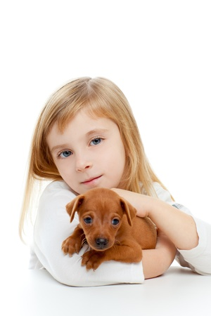 Blond children girl with dog puppy mascot mini pinscher on white background photo