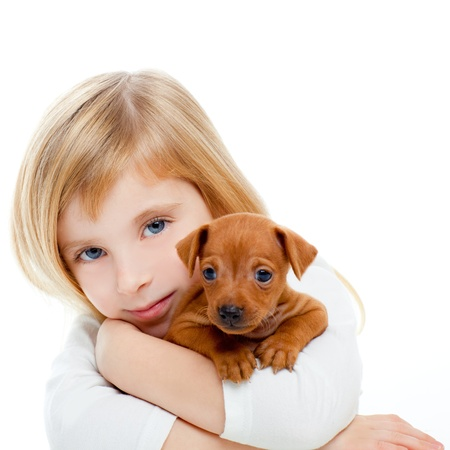 pinscher: Blond children girl with dog puppy mascot mini pinscher on white background