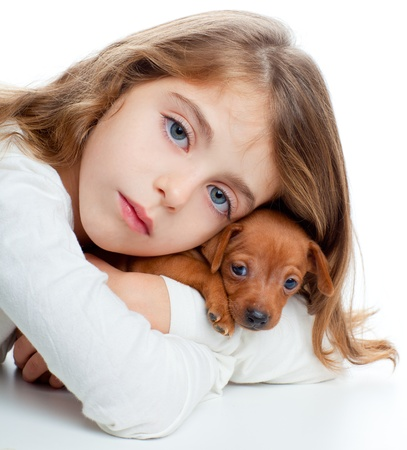 brunette kid girl with mini pinscher pet mascot dog on white background Stock Photo