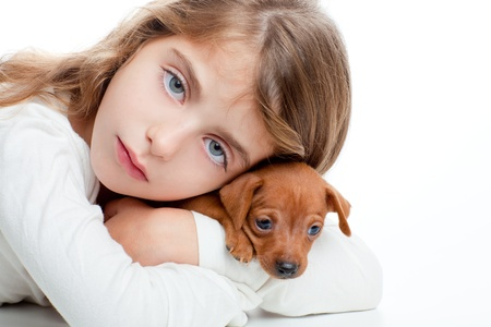 brunette kid girl with mini pinscher pet mascot dog on white background Stock Photo - 11268682