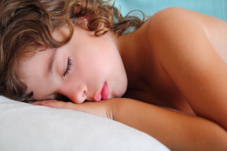 kind: child girl sleeping happy on pillow in summer time Stock Photo