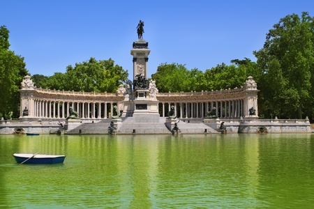 Buen Retiro park lake in Madrid with fallen angel statue