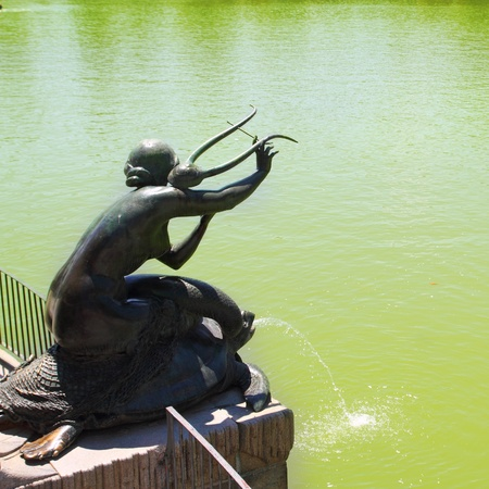 lyre: Madrid Sirena con Lira statue of mermaid in Retiro park lake