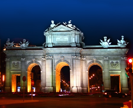 Alcala Puerta in Madrid with night lights in Spain
