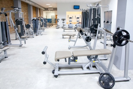 dumb: Fitness club gym with sport equipment modern interior