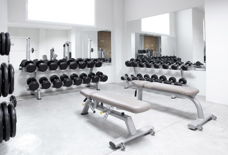 Fitness club weight training equipment gym modern interior Stock Photo - 11982196