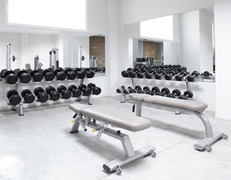 kilograms: Fitness club weight training equipment gym modern interior Stock Photo