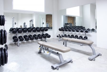 gymnasium: Fitness club weight training equipment gym modern interior Stock Photo