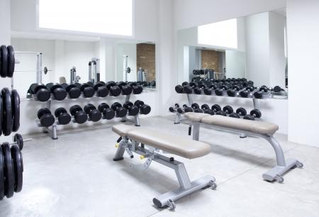 weight machine: Fitness club weight training equipment gym modern interior Stock Photo